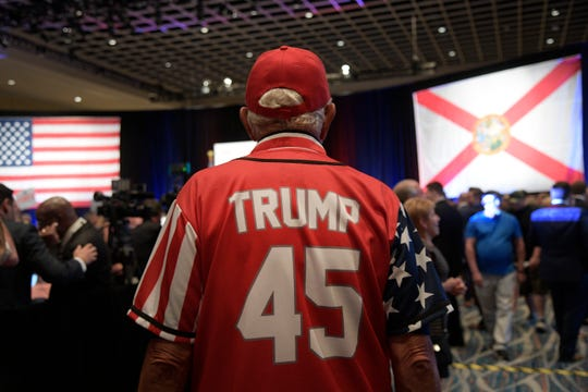 Stan Swies, 75, of The Villages, Fla., attends an election party for Florida Republican gubernatorial candidate Ron DeSantis Tuesday, Aug. 28, 2018, in Orlando, Fla.