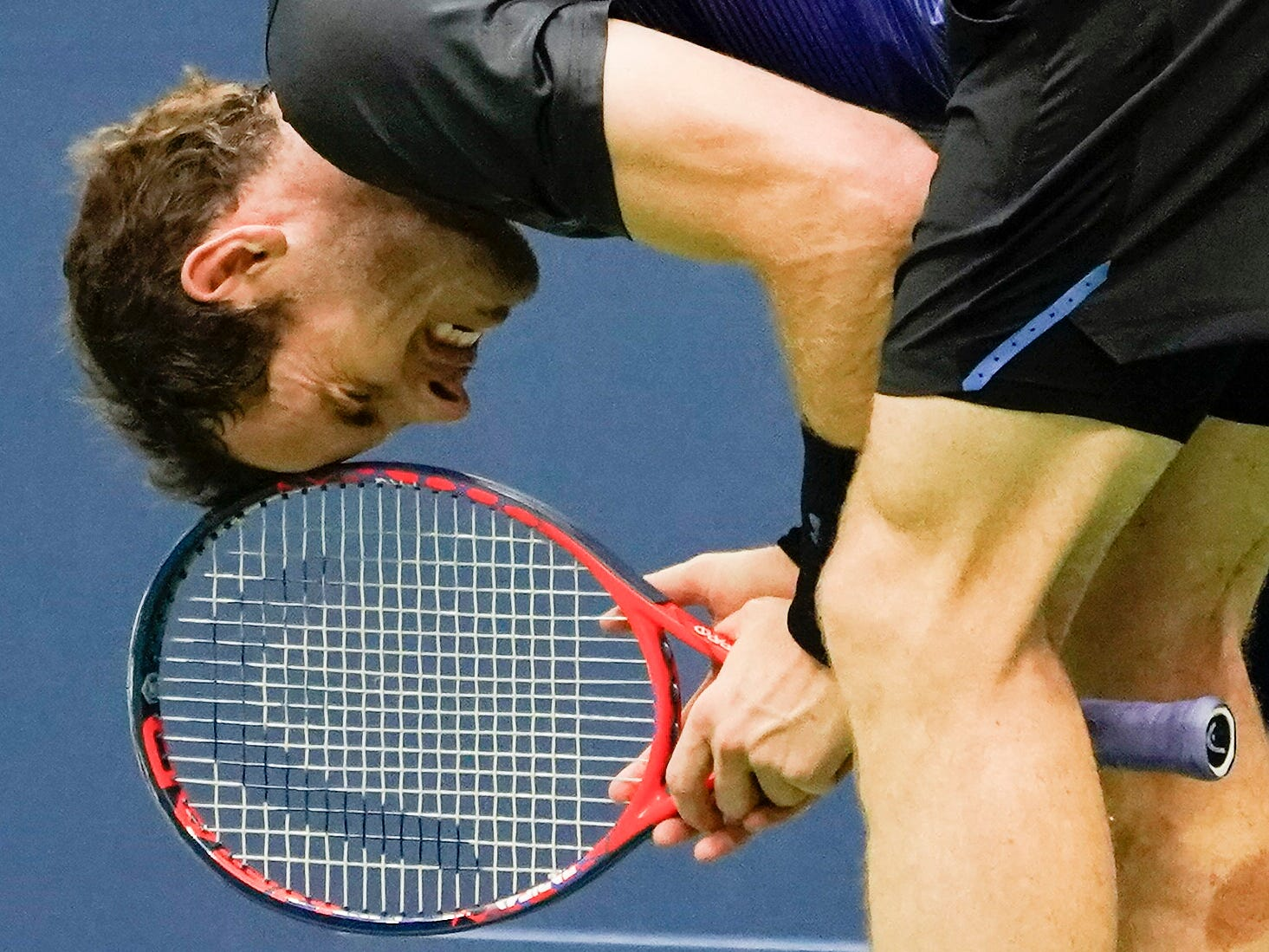 Andy Murray of the United Kingdom grimaces after a miss in the fourth set against Spain's Fernando Verdasco.