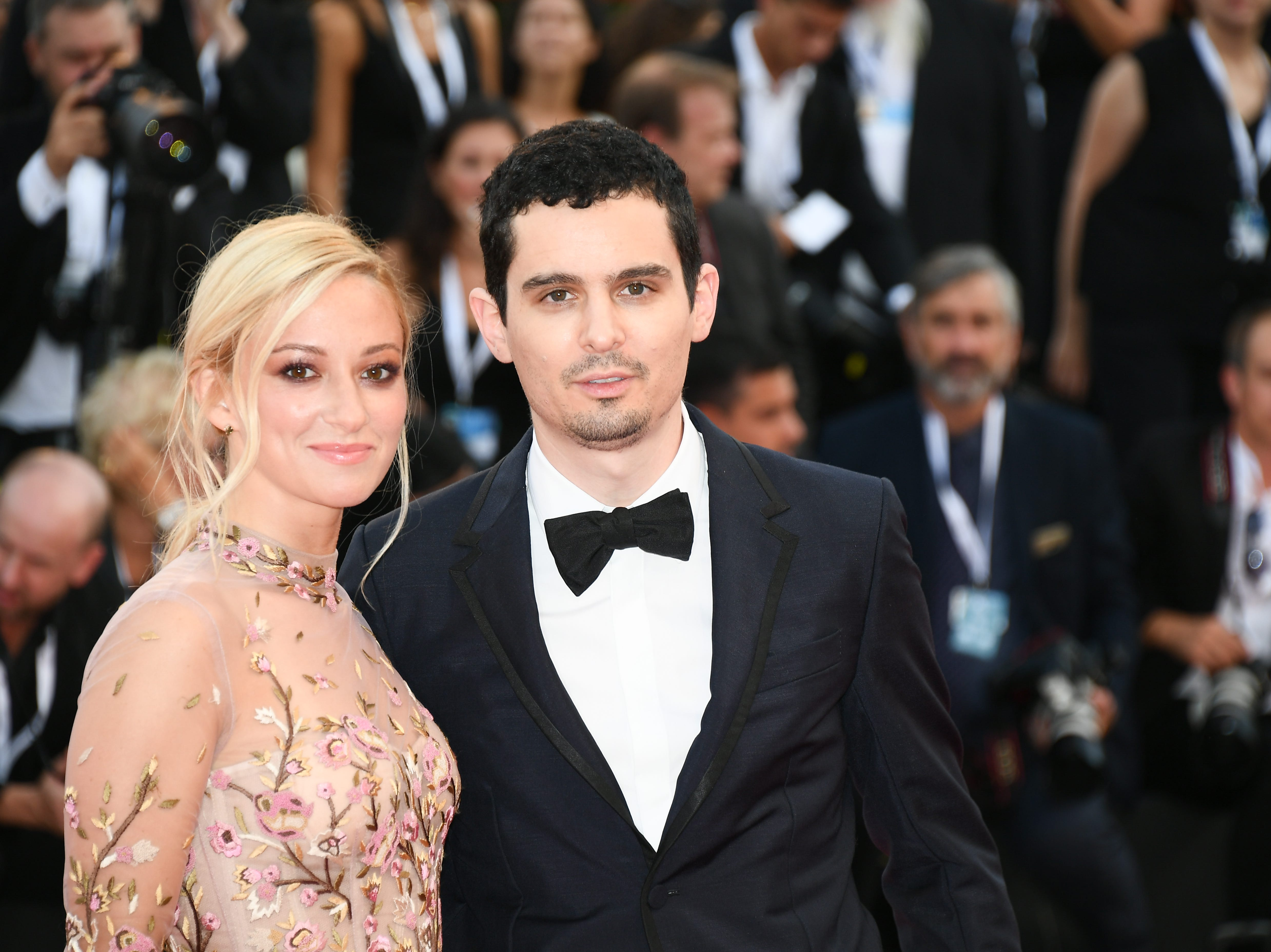 VENICE, ITALY - AUGUST 29:  Olivia Hamilton and Damien Chazelle walks the red carpet ahead of the opening ceremony and the 'First Man' screening during the 75th Venice Film Festival at Sala Grande on August 29, 2018 in Venice, Italy.  (Photo by Dominique Charriau/WireImage) ORG XMIT: 775200609 ORIG FILE ID: 1025072442