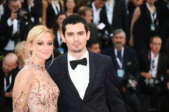 "Olivia Hamilton and Damien Chazelle walk the red carpet ahead of the ""First Man"" screening at Venice Film Festival on Aug. 29."