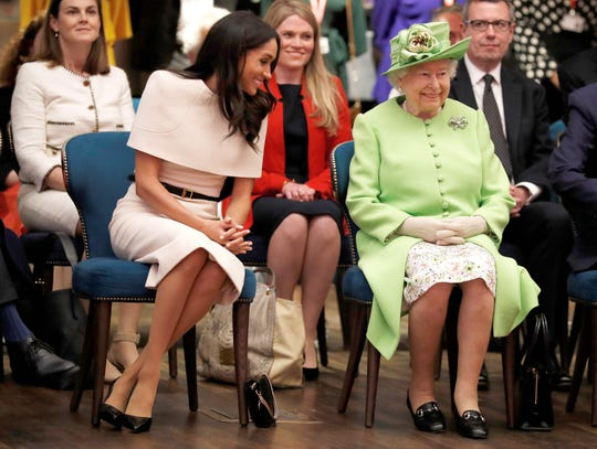 Queen Elizabeth II and Duchess Meghan of Sussex smile during their visit to  Cheshire, England, on June 14, 2018.