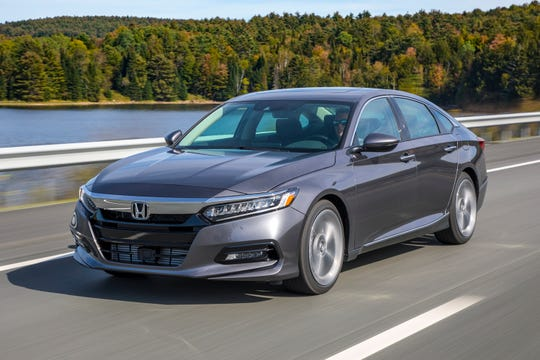 This undated photo provided by American Honda Motor Co. shows the 2018 Honda Accord. Labor Day shoppers in the Chicago area will find discounts in the $5,500 range. (Courtesy of American Honda Motor Co. via AP)