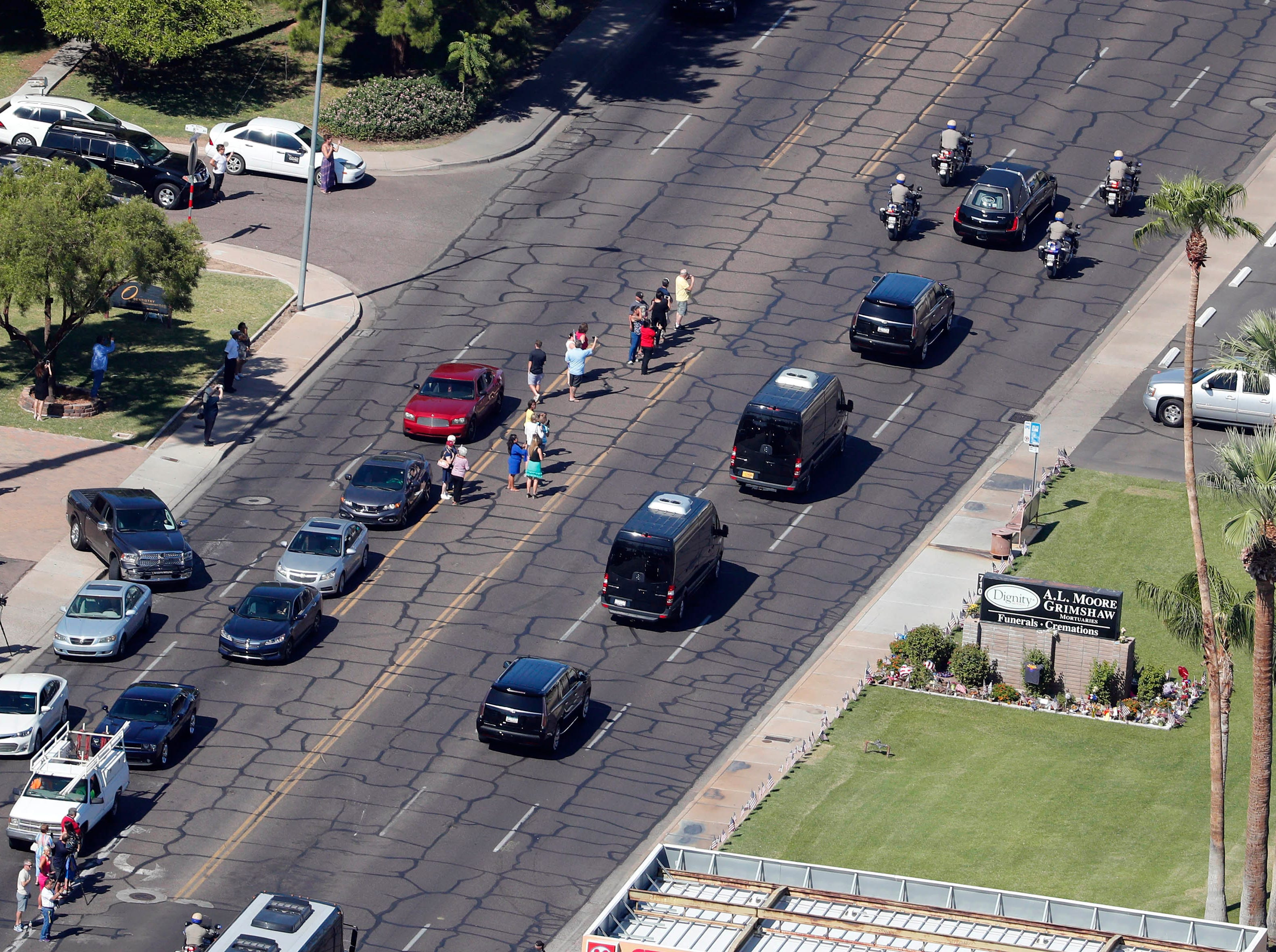 The motorcade carrying the body of Sen. John McCain makes its way to the Arizona State Capitol in Phoenix where the senator will lie in state. The six-term Arizona senator died Saturday after a 13-month battle with brain cancer.