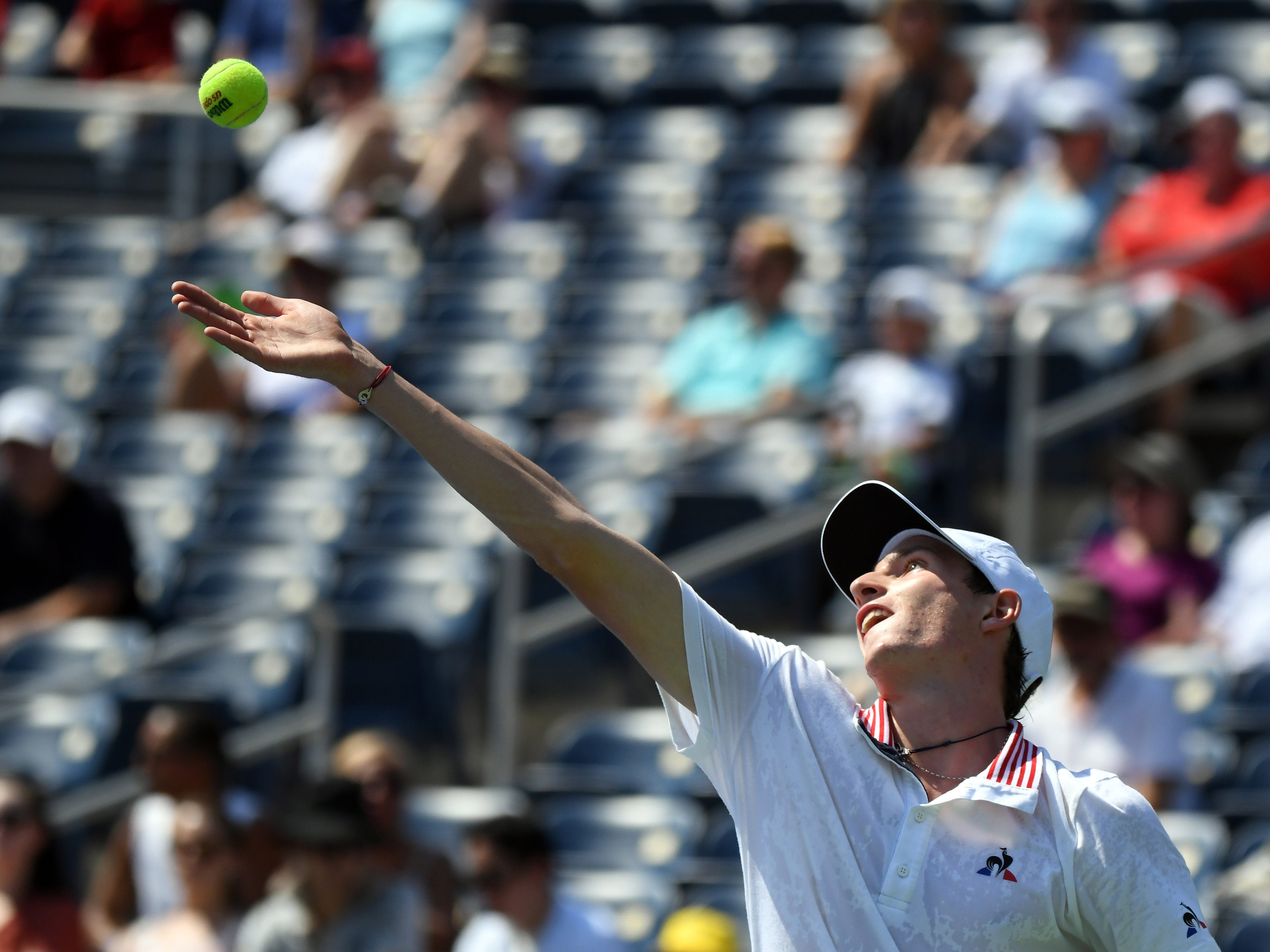 Ugo Humbert of France serves to Stan Wawrinka of Switzerland.