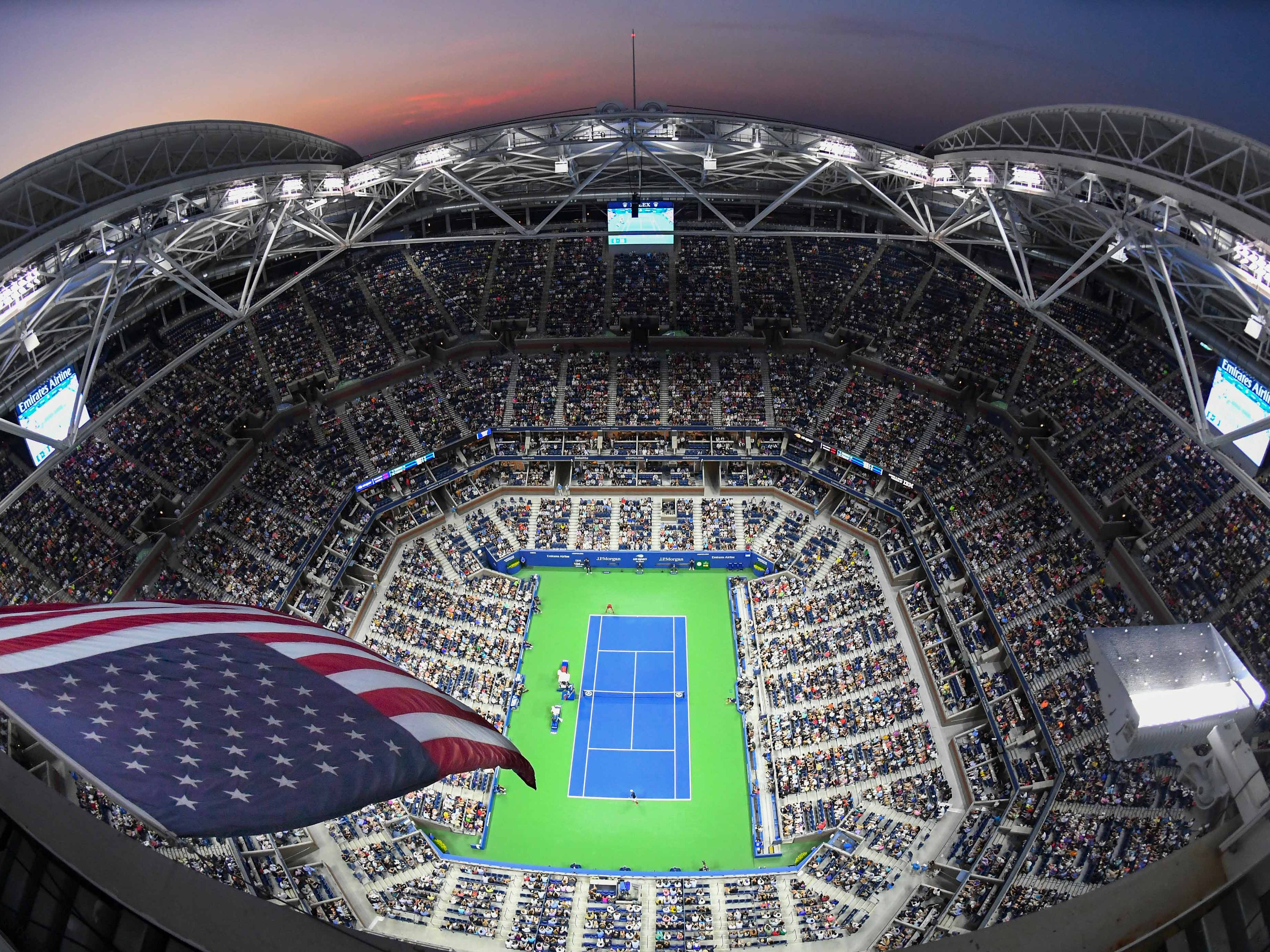 Night falls at Arthur Ashe Stadium.