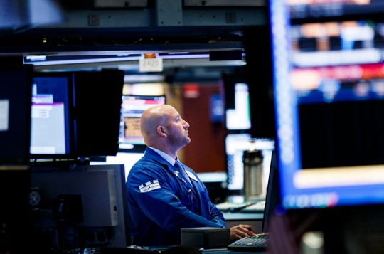 epa06908585 A trader works on the floor of the New York Stock Exchange in New York, New York, USA, on 24 July 2018. The Dow Jones industrial average closed up nearly 200 points.  EPA-EFE/JUSTIN LANE ORG XMIT: JLX16