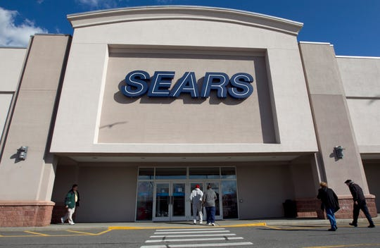 ORG XMIT: MASR201 In this photo on February 22, 2012, shoppers enter a Sears department store site in Dedham, Mass. Sears Holdings extends its partnership with Amazon and allows tire buyers to install them at a local Sears Auto Center. (AP Photo / Steven Senne)