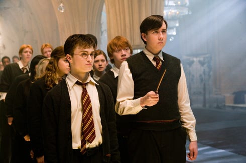 "Harry Potter (Daniel Radcliffe, left) conducts other students in a meeting of Arm Dumbledore, a student attendant group, in ""Harry Potter and the Phoenix Order""."