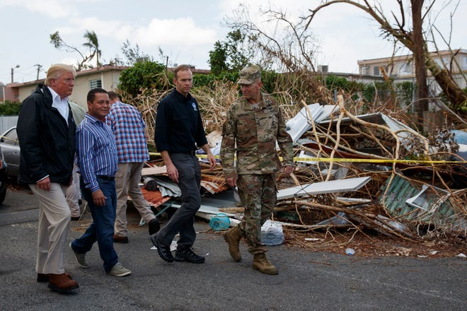 President Donald Trump tours a neighborhood damaged in Hurricane Maria Oct. 3, 2017, in Guaynabo, Puerto Rico.