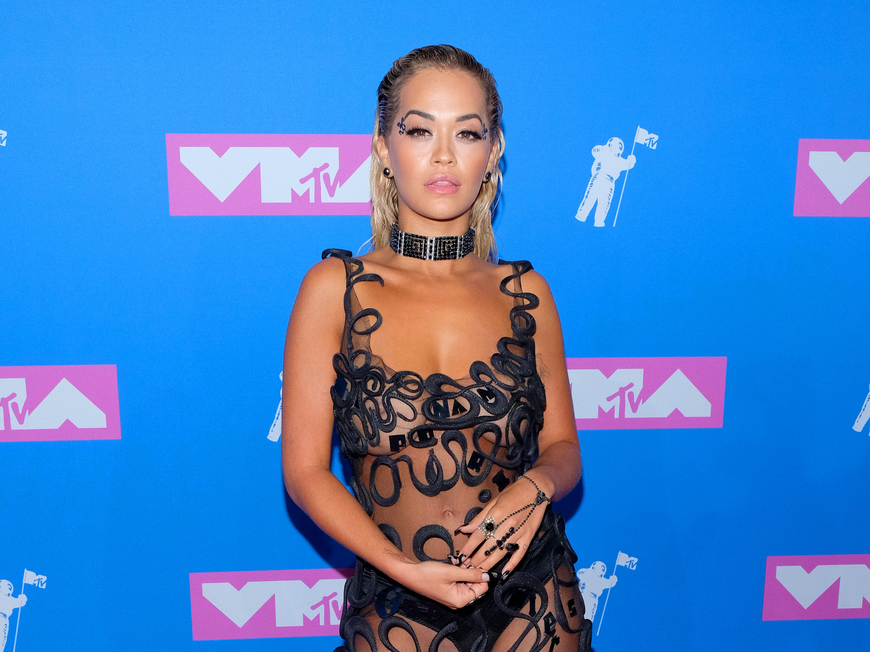 Rita Ora looked sultry at the 2018 MTV Video Music Awards in a sheer gown.