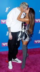 Pete Davidson and Ariana Grande couldn't help but kiss each other at the MTV Video Music Awards.