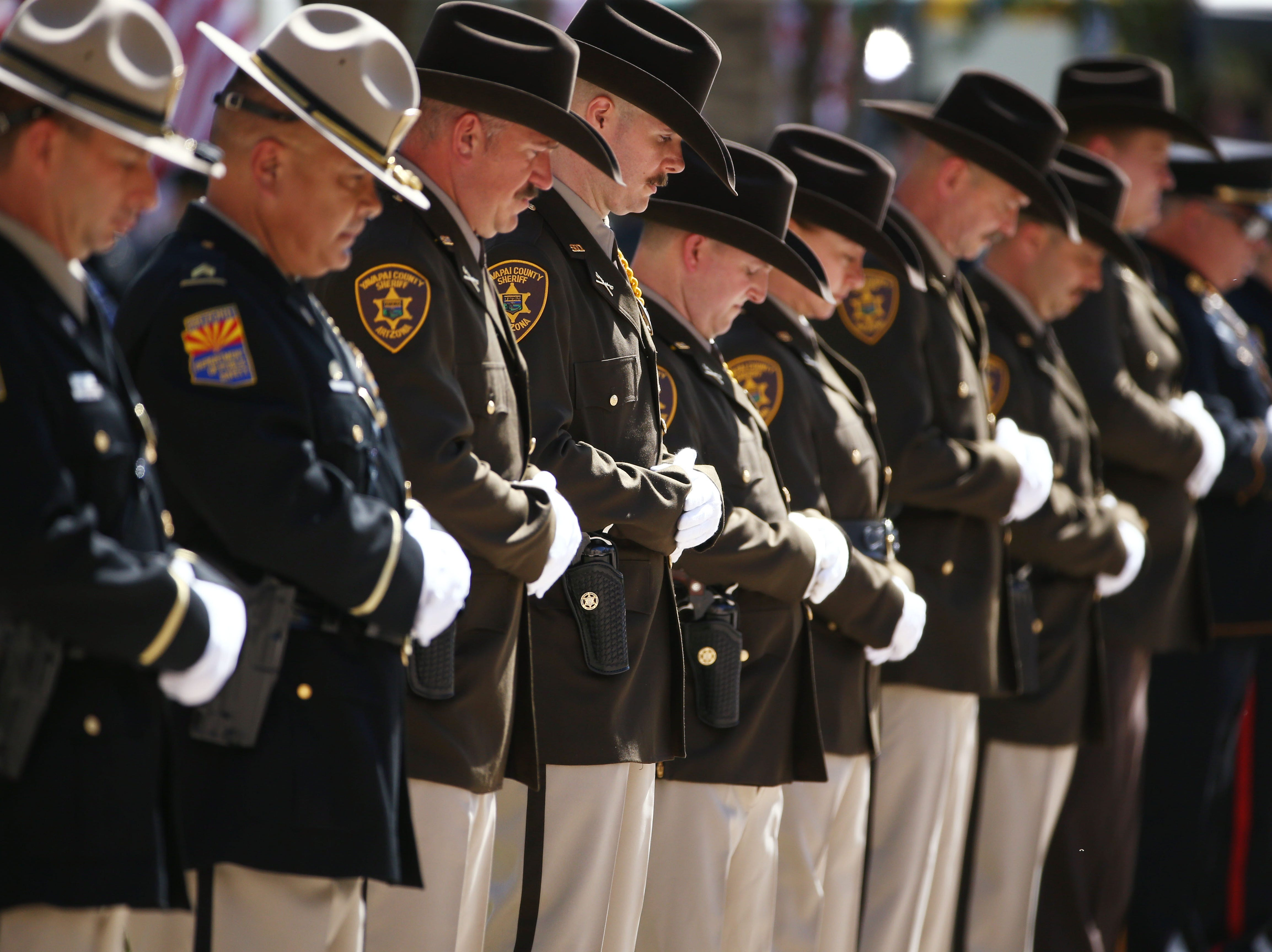 Officers line the plaza as the casket of U.S. Sen. John McCain arrives for his memorial service at the Arizona State Capitol.