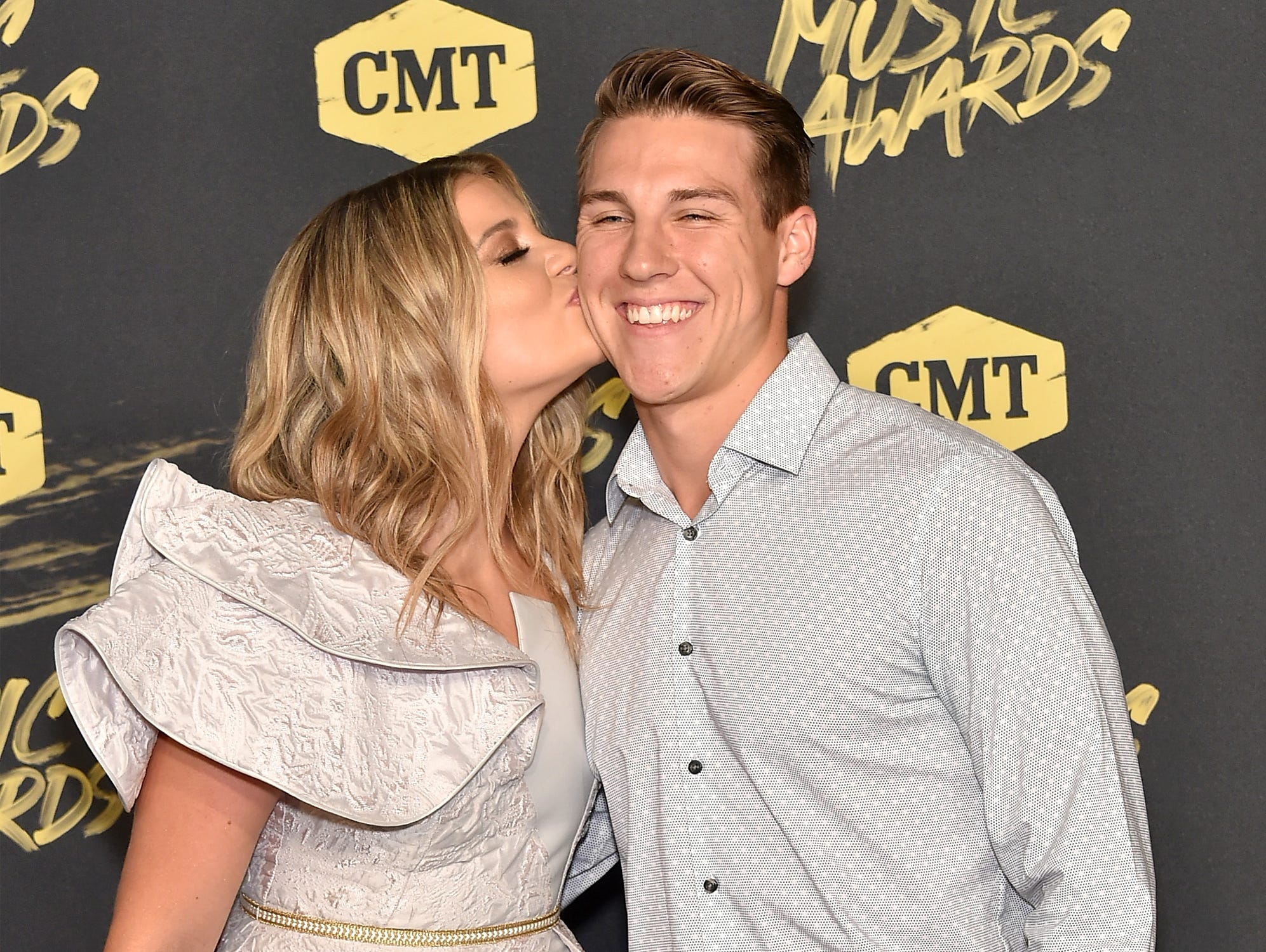 Country singer Lauren Alaina gave fiance Alex Hopkins a smooch at the CMT Music Awards on June 6, 2018 in Nashville.