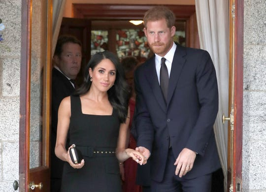 Prince Harry and Duchess Meghan of Sussex at a party at the British Ambassador's residence in Dublin, Ireland, July 10, 2018.