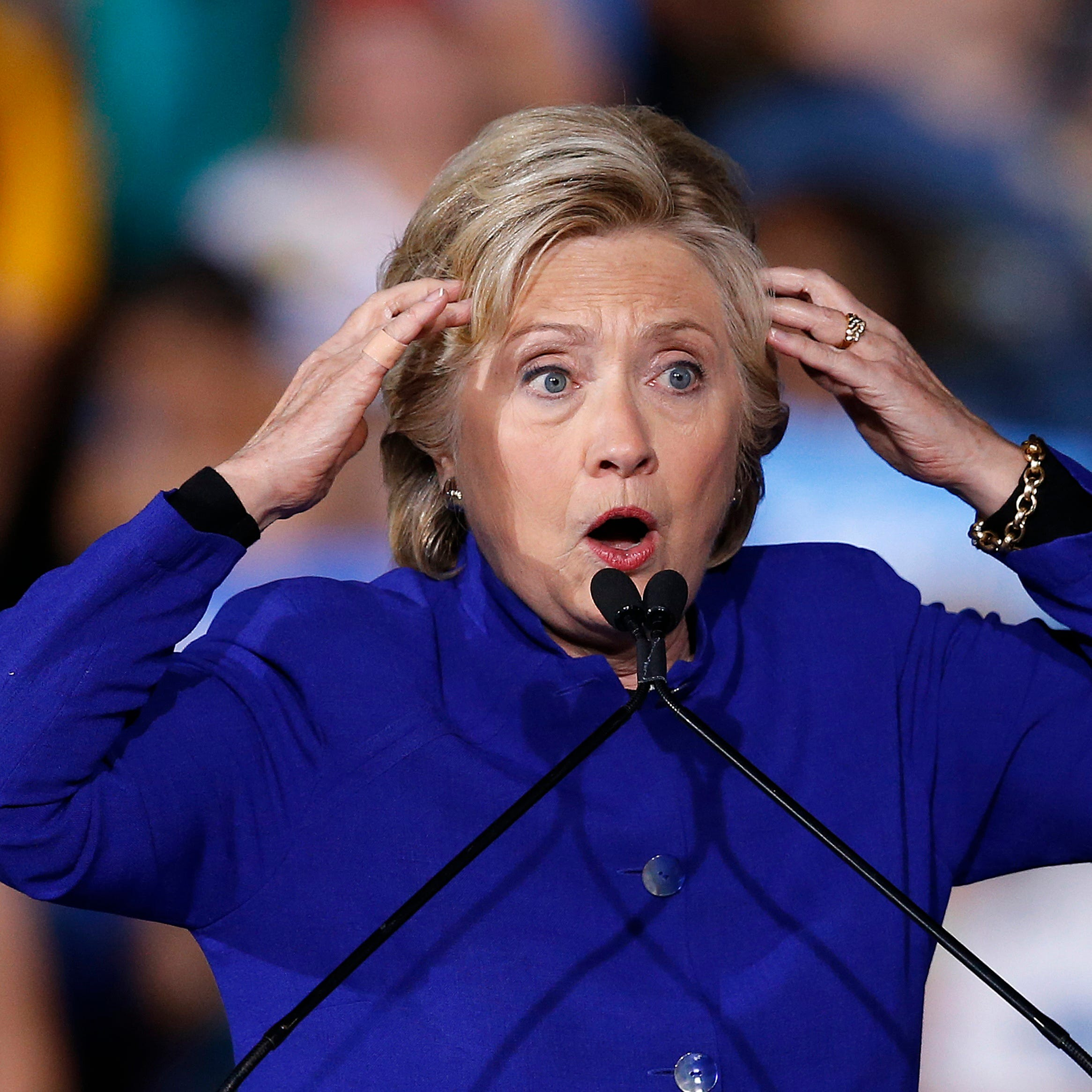 Then-Democratic presidential candidate Hillary Clinton gestures as she speaks at a campaign rally on Nov. 2, 2016, in Tempe, Ariz.