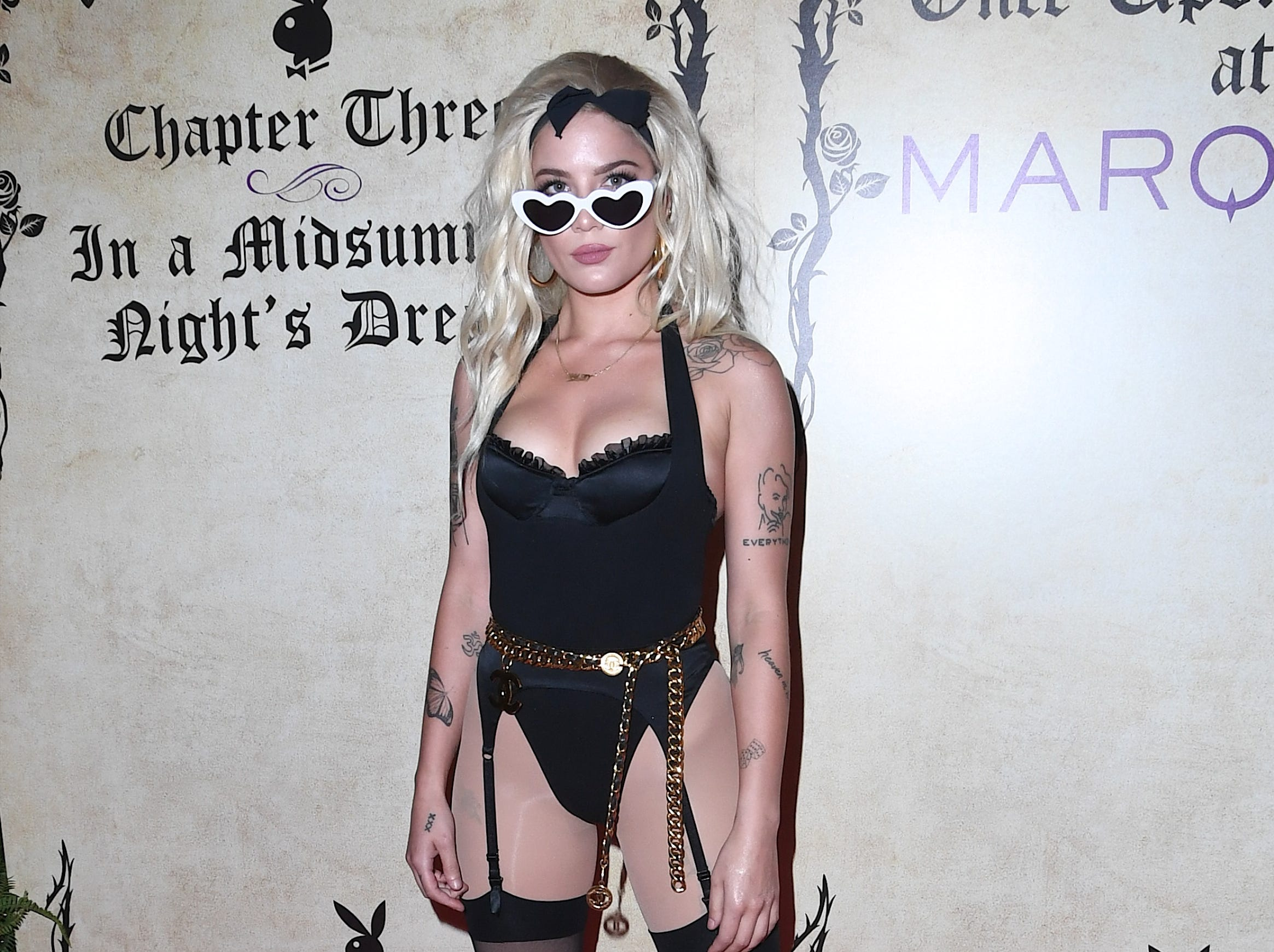 Halsey arrived at Playboy's Midsummer Night's Dream in a body suit and tights on July 29, 2018 in Las Vegas.