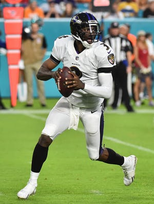 Baltimore Ravens quarterback Robert Griffin III (3) drops back to attempt a pass against the Miami Dolphins during the first half at Hard Rock Stadium.