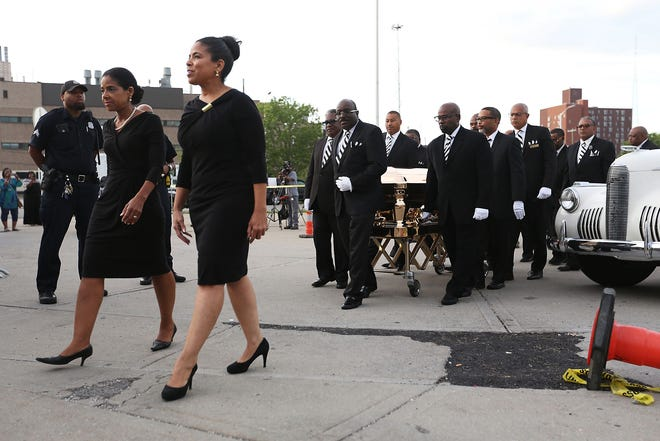 Linda Swanson, third from left, of Swanson Funeral Home, walks ahead of Aretha Franklin's casket on the second day of a public viewing for Franklin at the Charles H. Wright Museum of African American History in Detroit on Wednesday, Aug. 29, 2018.