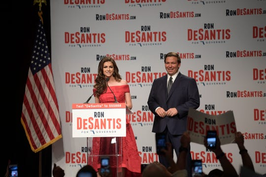 Florida Republican gubernatorial candidate Ron DeSantis, right, listens as his wife Casey introduces him at an election party after winning the Republican primary Tuesday, Aug. 28, 2018, in Orlando, Fla.
