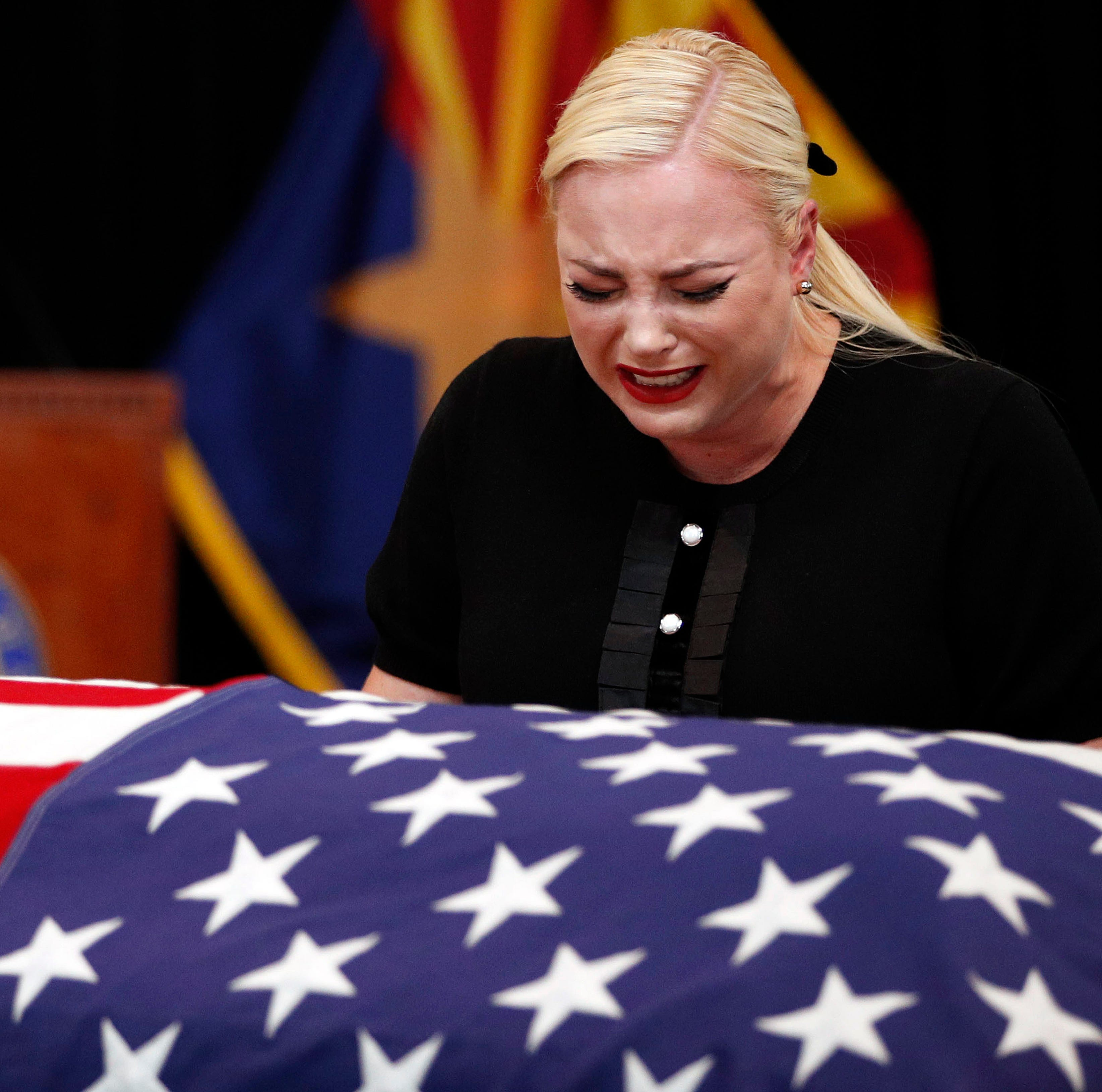 Meghan McCain, daughter of, Sen. John McCain, R-Ariz. cries at the casket of her father during a memorial service at the Arizona Capitol on Weds. Aug. 29, 2018, in Phoenix.