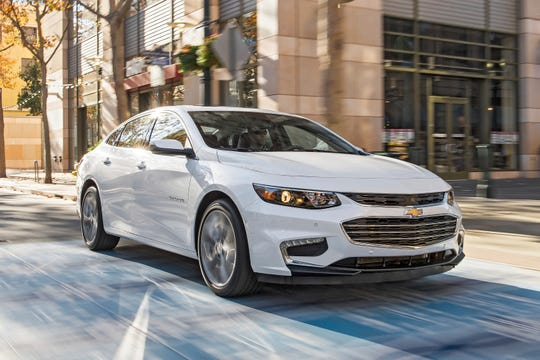 This undated photo provided by General Motors shows the 2018 Chevy Malibu. In the Fort Lauderdale, shoppers will find savings up to $9,000 during Labor Day sales. (Jessica Lynn Walker/General Motors via AP)
