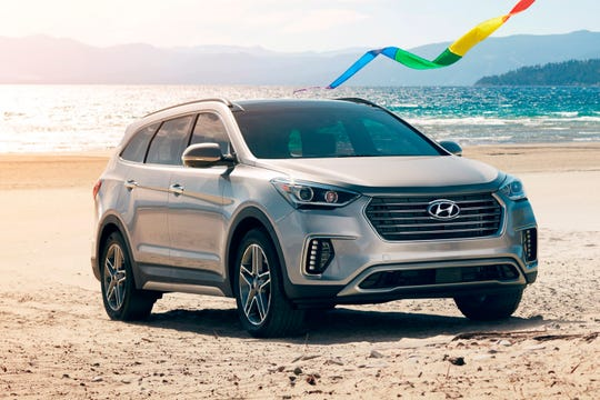 This undated photo provided by Hyundai Motor America shows the 2018 Hyundai Santa Fe. In the Los Angeles area, expect Labor Day discounts of up to $7,800, depending on the trim. (Courtesy Hyundai Motor America via AP)
