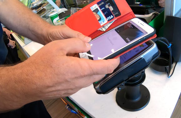 The advantages of using Apple Pay instead of a credit card with the embedded chip.  (