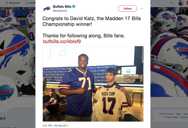 "David Katz, right, shown in a 2017 photo after winning a Buffalo Bills ""Madden"" video game tournament. Katz killed two fellow gamers in Jacksonville, Florida, on Sunday before turning the gun on himself."