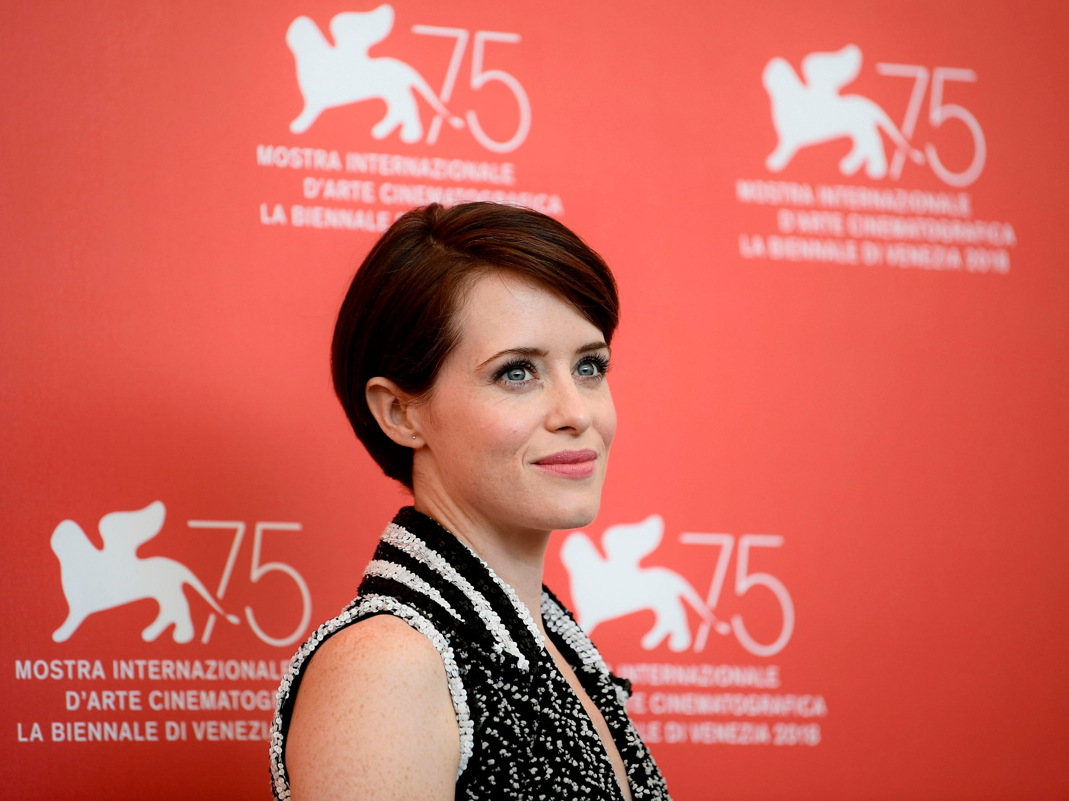 """Actress Claire Foy poses during a photocall for the film """"First Man"""" on August 29, 2018 prior to its premiere in competition at the 75th Venice Film Festival at Venice Lido. (Photo by Filippo MONTEFORTE / AFP)FILIPPO MONTEFORTE/AFP/Getty Images ORIG FILE ID: AFP_18O8ZM"""