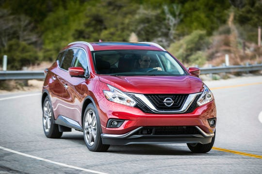 This undated photo provided by Nissan North America shows the stylish 2018 Nissan Murano. Savings of nearly $10,000 can be had in the Chicago area as Labor Day approaches. (Courtesy of Nissan North America via AP)
