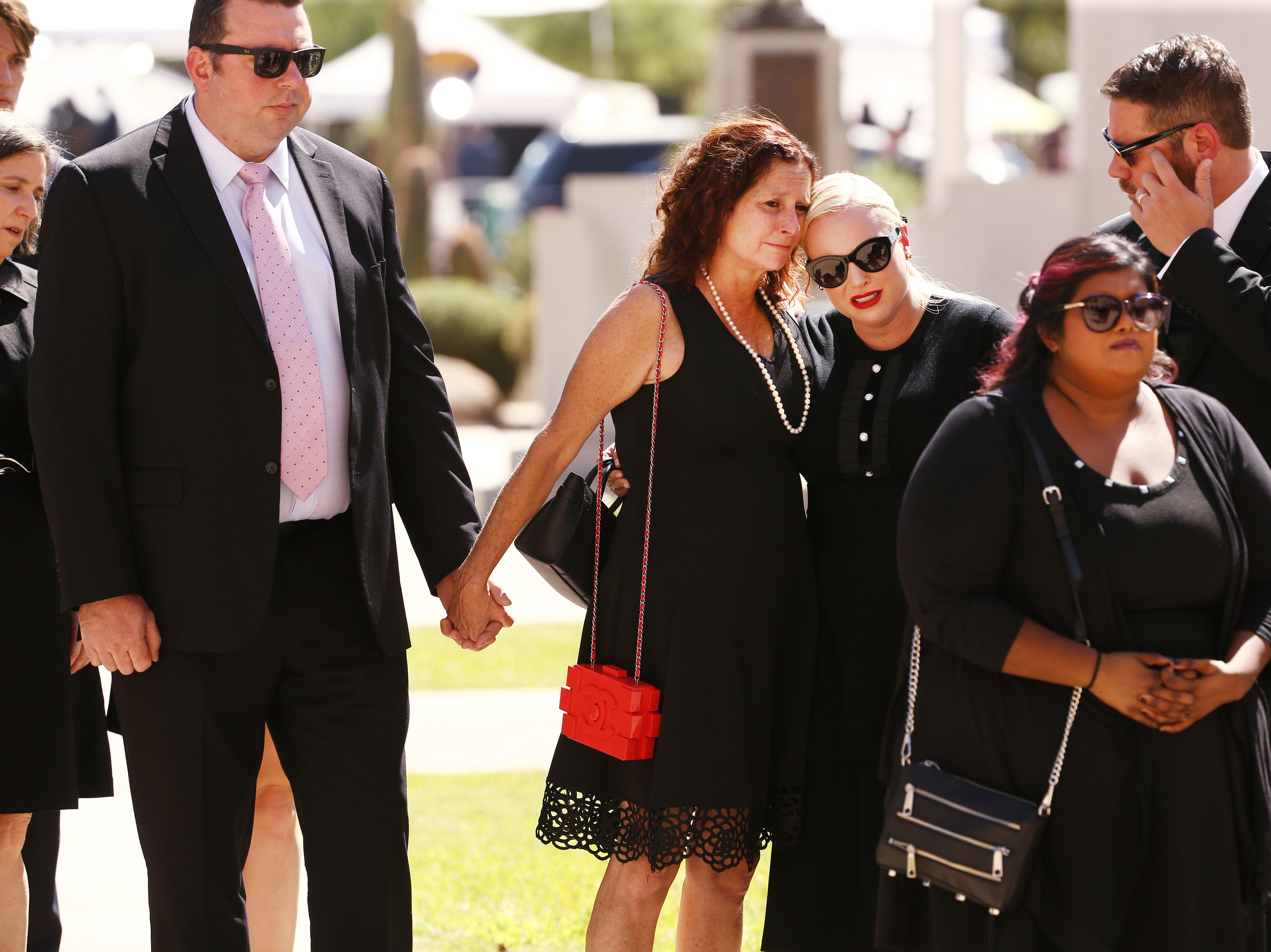 Daughters Sidney McCain, Meghan McCain and Bridget McCain, right, follow the casket of their father U.S. Sen. John McCain for his memorial service at the Arizona State Capitol.