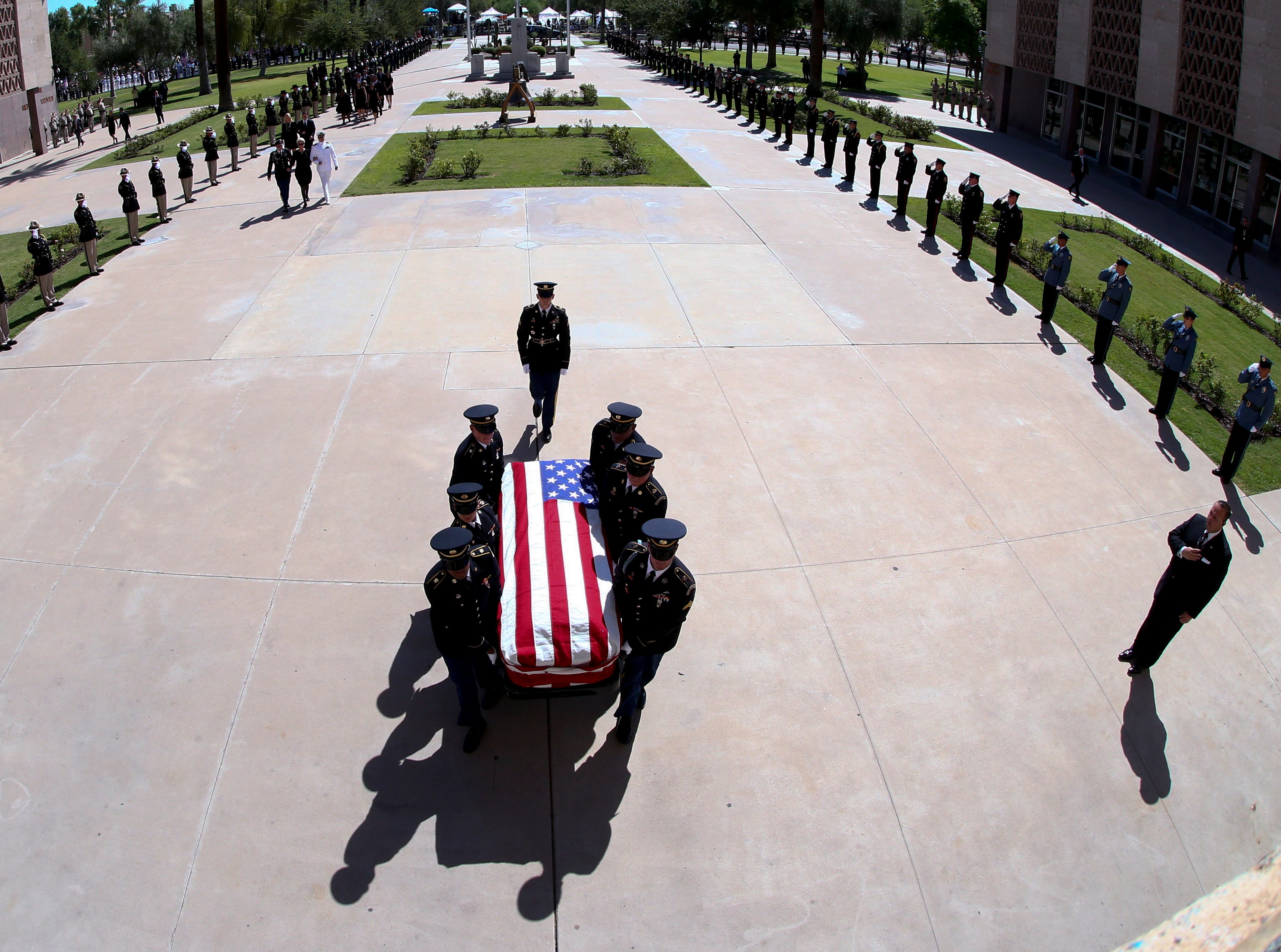 The Arizona Army National Guard honor guard carry the casket of Senator John McCain during a memorial service at the Arizona Capitol, in Phoenix, Ariz. on Aug. 29, 2018.