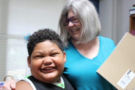 Dominik Glorioso smiles as he gets a hug from Deb Faircloth, a legal advocate. The boy had just given Faircloth, a legal advocate who works out of the Family Justice Center of Central Louisiana, a birthday present.