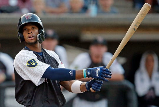 Outfielder Keon Broxton hits a foul ball while playing for the Wisconsin Timber Rattlers on Wednesday night.