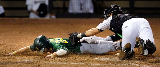Payton Henry of the Wisconsin Timber Rattlers puts the tag on Jack Meggs of the Beloit Snappers in a Midwest League game Wednesday at Neuroscience Group Field at Fox Cities Stadium in Grand Chute.