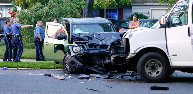 Lakewood Police are shown at the scene of a head-on collision in front of 1470 Lanes Mill Road Thursday morning, August 30, 2018.