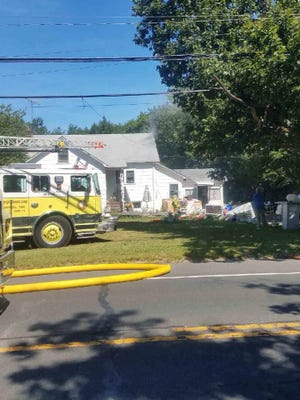Crews battled a house fire on Route 33 in Howell Thursday afternoon.