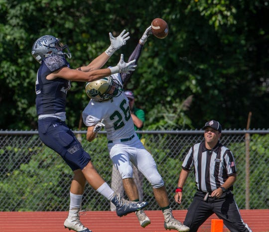 Pinelands' Robert LeFevre knocks away a potential touchdown pass to Mater Dei's Christoper Autino during first half action. Mater  Dei football vs Pinelands on August 30, 2018 in Middletown, NJ.
