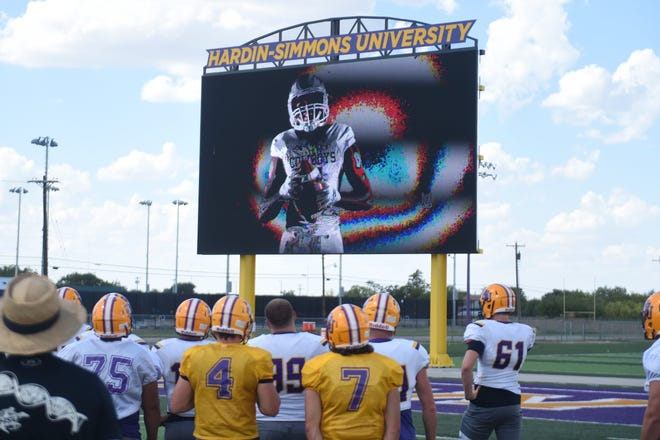 The Hardin-Simmons football team announced a new uniform and helmet for the 2018 season on the video board before practice on Thurday, Aug. 30, 2018. The 'Ice Age' helmet will be the first new helmet for the program since 1990.