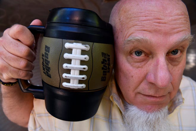 Abilene Reporter-News editor Greg Jaklewicz holds the Rembrandt of Bubba Kegs.