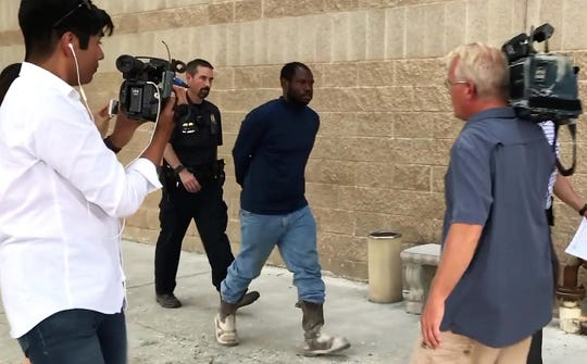 Joshua Day, 38, is escorted from the Law Enforcement Center by Abilene police on Thursday, Aug. 30, 2018, after being arrested on attempted sexual assault and other charges.
