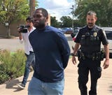 Abilene police escort Joshua Day, who was arrested on Thursday, Aug. 30, 2018 on four attempted sexual assault and other charges.