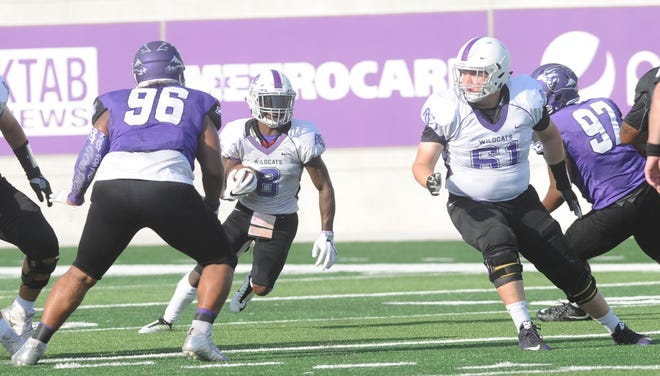 Wylie grad Kade Parmelly (61) blocks for an ACU receiver during the Wildcats' scrimmage Aug. 18 at Wildcat Stadium. Parmelly is listed as ACU's starter at right offensive tackle for Saturday's game at Baylor.