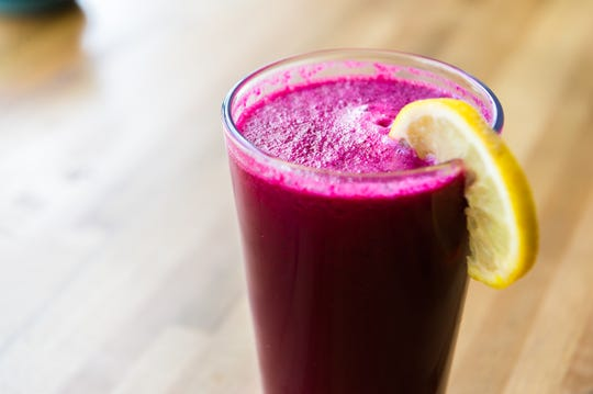 The Liver Love juice made with beet, celery, carrot, lemon and apple, offered at Simple Cafe and Juice Bar on Haywood Road in West Asheville, owned by Nate Kelly and Suzy Salwa Phillips.