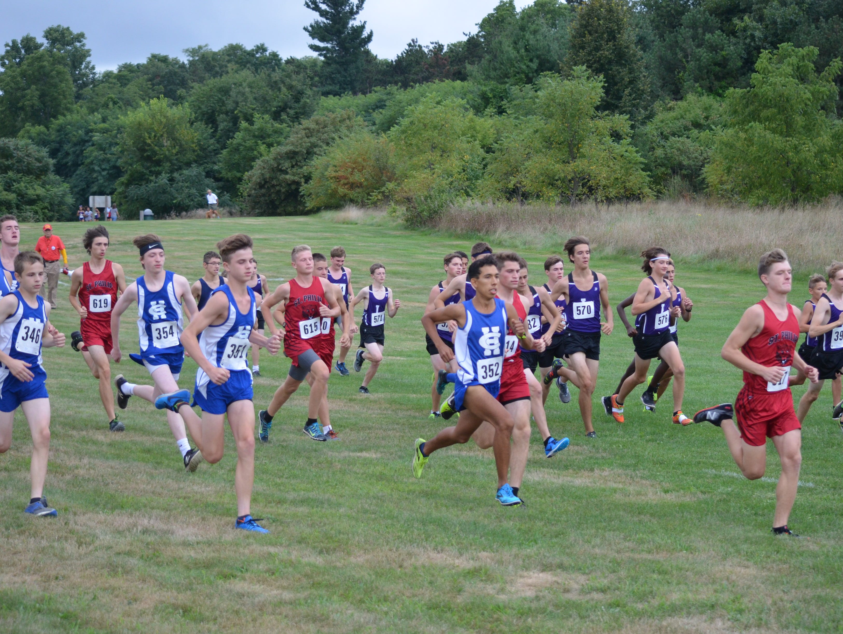 Runners take off from the starting line at the 2018 All-City Cross Country Meet.