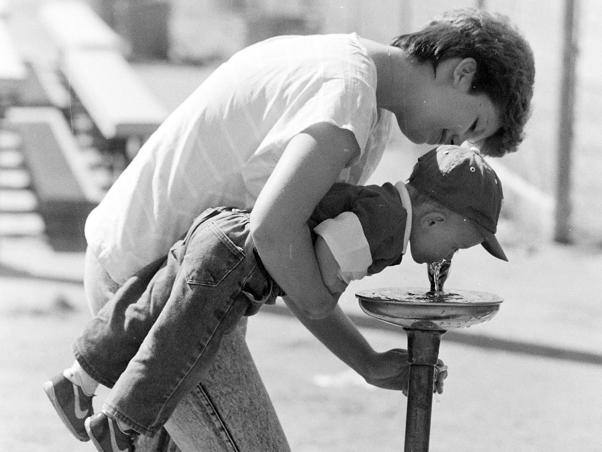 06/03/88Boy Getting Drink of Water