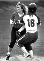 Central Kitsap's Heidi Westhoff and North Kitsap's Laura Jurgwirth collide during a April 1988 softball game.