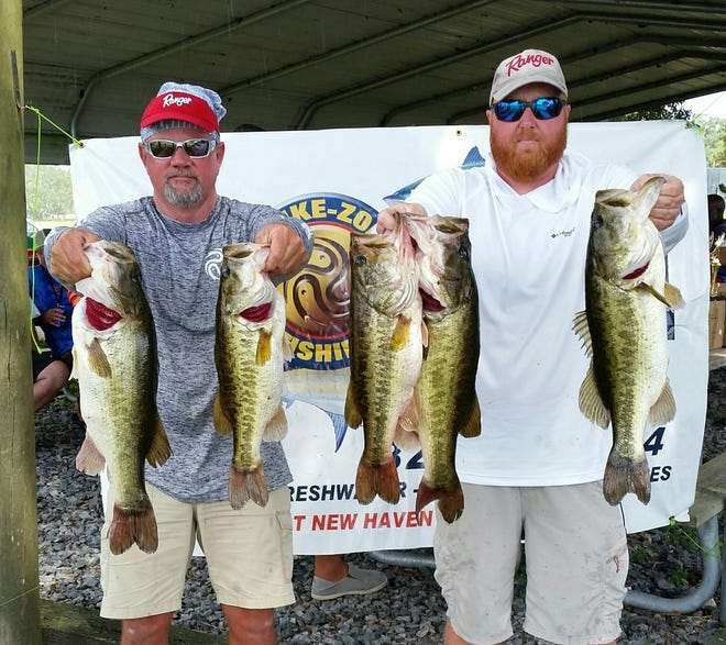 Brian Wical, right, and Craig Cashion show their five-bass limit that won the season-ending Classic Championship for the Space Coast Bass Fanatics at Lake Kissimmee on August 26.  The catch weighed 25.80 pounds. It wrapped up a record-setting year for Wical and Cashion and also for the fishing club.