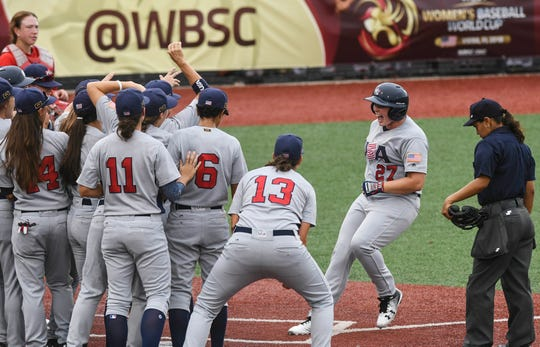 Megan Baltzell of the USA celebrates a home run with her teammate during Wednesday's game.