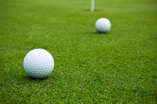 Golf Balls On Putting Green